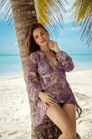 Beautiful female model on the beach Stock Photo