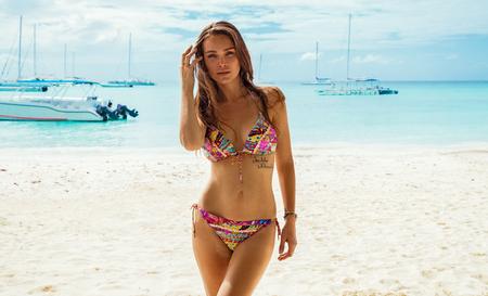 Sexy female model in bikini on the beach