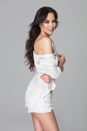 Beautiful smiling young woman wearing a white shirt