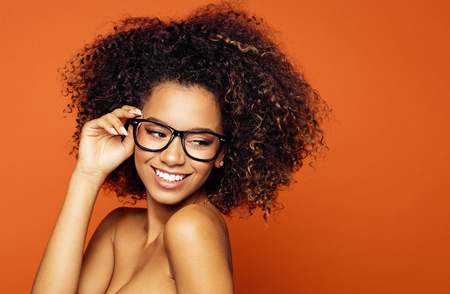 Beautiful black woman smiling and wear sunglasses. Space for your text