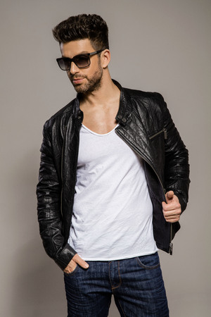 Handsome man in leather jacket wear sunglasses