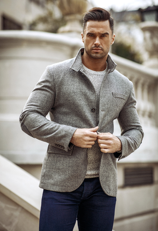 Portrait of handsome man in gray stylish jacket