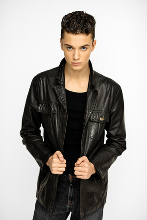 Sexy young man in black jacket