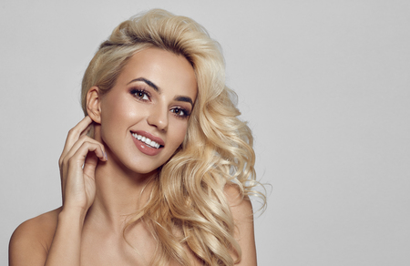 Blonde smiling model with copy space