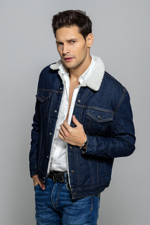 Young handsome man wearing jeans clothes Stockfoto