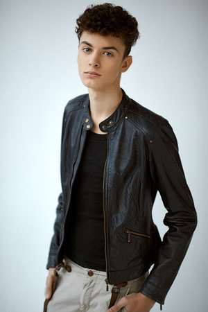 Portrait of young handsome boy in leather jacket
