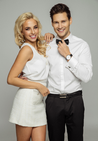 Valentines photo of young happy couple in love isolated on gray background Stockfoto