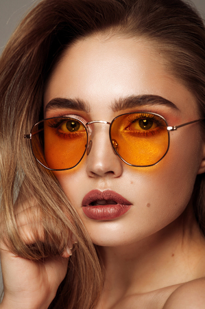 Close up face of young girl wear sunglasses