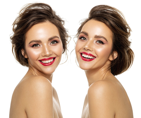 Photo of beautiful smiling twins model with white teeth isolated on white background