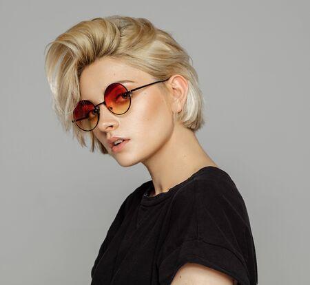 Portrait of blond woman in retro sunglasses