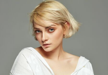Portrait of beautiful blonde woman with short hair