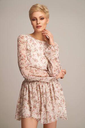 Fashion beautiful elegant woman posing in short summer dress Standard-Bild