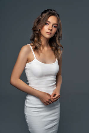Sexy woman in white dress looking at camera Stockfoto