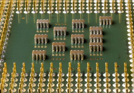Old computer processor with gold-plated legs, microcircuits on it, super macro photo Reklamní fotografie