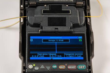 optical fiber welding workflow, welding machine display, close-up