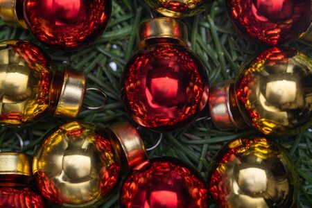 Red and yellow christmas balls on spruce needles