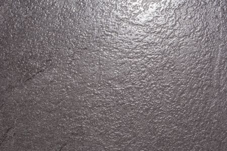 Grey rough textured wall coating texture photo closeup texture of gray artificial stone with recesses