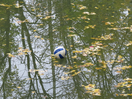 oversight: The ball, which fell into the water during a game of volleyball. Stock Photo