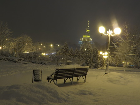 snowlandscape: bench in the park at night Stock Photo