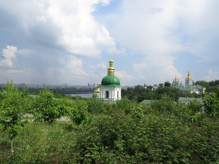 Kiev-Pechersk Lavra on the background of local gardens. photo