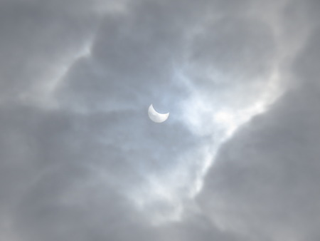 man in the moon: Solar eclipse on a background of clouds.