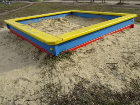 sandpit: Small square sandpit in the playground outside. Stock Photo