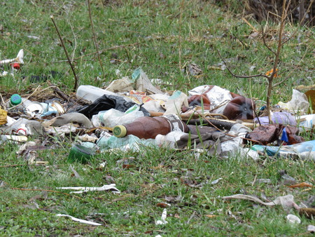 food waste: A large pile of debris from the bottles and food waste.