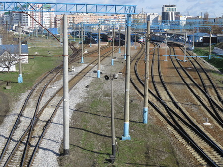 flatcar: A number of rails near the station.