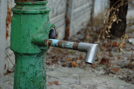 well water: Well water and column, pump it from a well. Stock Photo