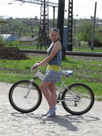 road bike: Girl rides a bike on rural road.