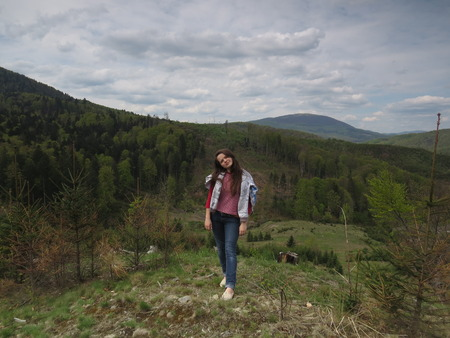 strong wind: Girl in the Carpathian mountains, where strong wind.