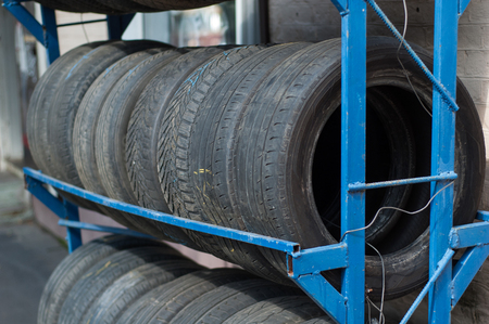 pneumatic tyres: Black tires from cars stacked in a row