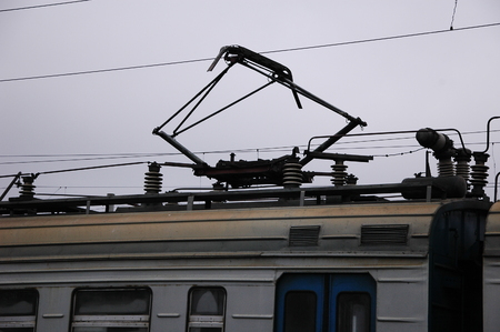 The current collector on an electric train close-up.