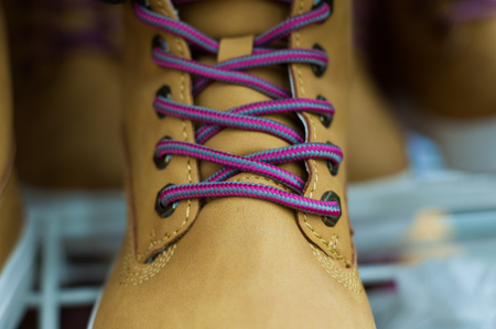 Brown all-weather womens shoes in the store. Stock Photo