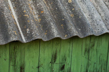 An old half-rotten slate roof in a barn.