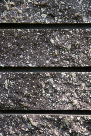 Abstract artistic background: a few gray bricks in a laying.