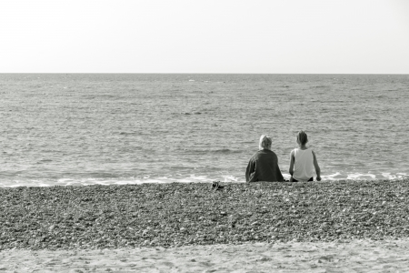 two friends are sitting at the sea Stock Photo