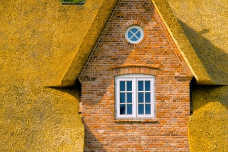 The gable of a thatched house Stock Photo