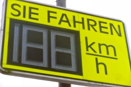 fined: German billboard - A billboard announcing in the road traffic for information to the current velocity
