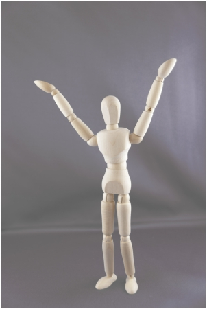 A dummy is holding his arms questioningly in the air  Stock Photo