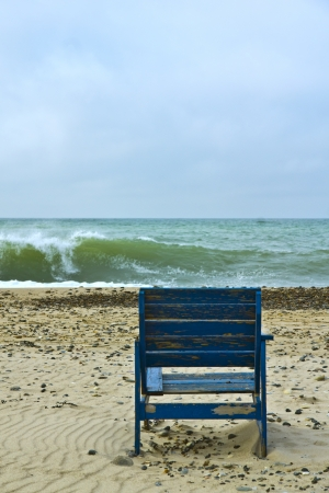 easy chair: Ocean view - A garden chair invites you to sit at the beach Stock Photo