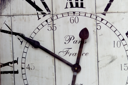 time specification: Time - A cutout of an old wooden wall clock in black and white   Stock Photo