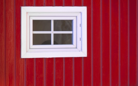transom: A white lattice window on red wooden background