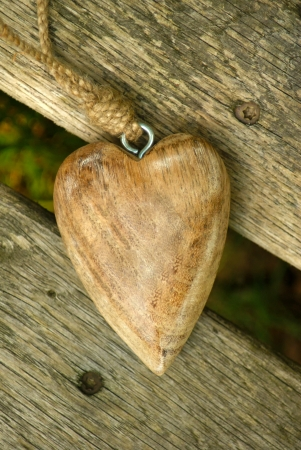 cordiality: Wooden Heart - A carved wooden heart on a wooden beam