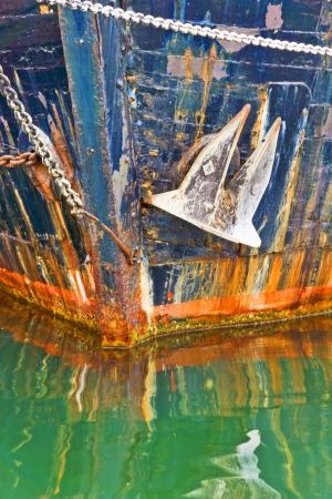 prow: Soul seller - The prow of an old ship with anchor in water