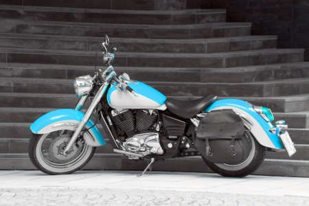 Motorbike in turquoise - A Motorbike in turquoise with black and white background