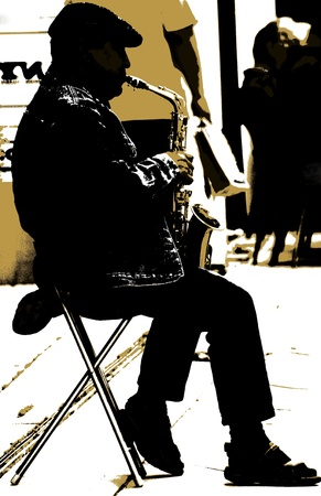 The saxophonist - A man is playing a saxophon on the street