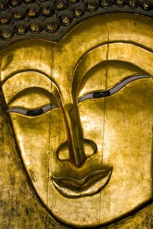 attentiveness: Buddha - A wooden golden Buddha face
