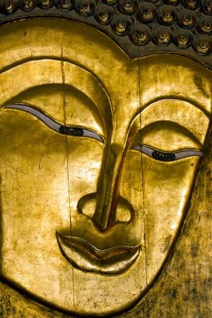 nirvana: Buddha - A wooden golden Buddha face