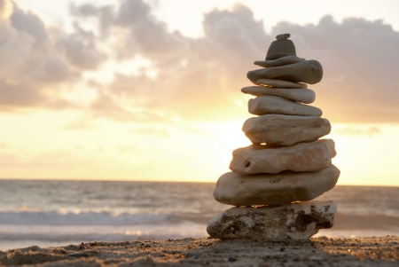 adroitness: Balance - A composition of stacked stones on the beach